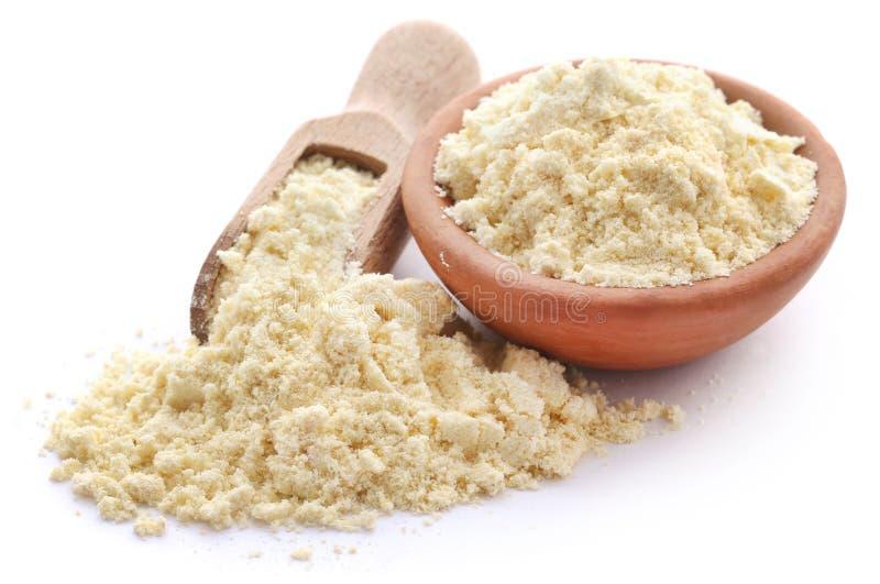 Gram flour. Closeup over white background royalty free stock photo