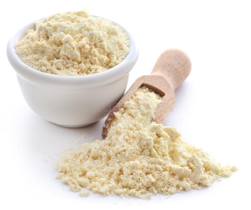 Gram flour. Closeup over white background stock images