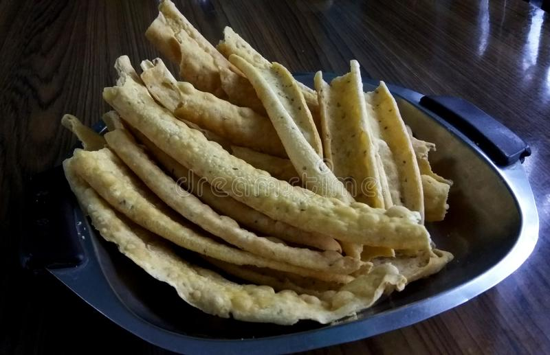 Gram flour papdi. A close up click of salty Indian snacks called as papda aka papdi is a gram flour based fried food item royalty free stock photo