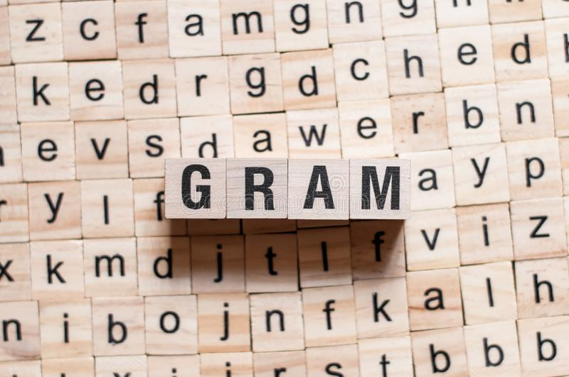 Gram word concept. On cubes royalty free stock photography