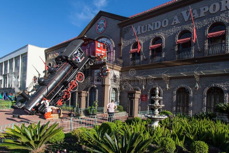 Gramado Mundo a Vapor Brazil. The facade of Mundo a Vapor steam engine museum with its Locomotive accident. Gramado, Rio Grande do Sul, Brazil stock images