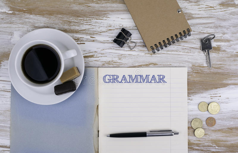Grammaire - cahier sur le bureau photographie stock libre de droits