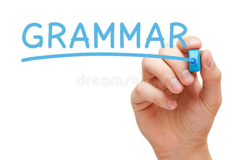 Grammatik-Handschrift mit blauer Markierung lizenzfreies stockbild