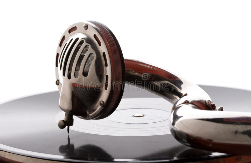 Gramophone pickup. Old gramophone pickup closeup playing vinyl record stock image