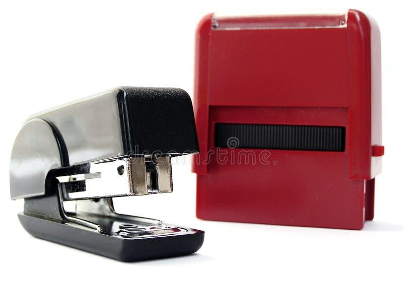Grampeador e selo imagem de stock