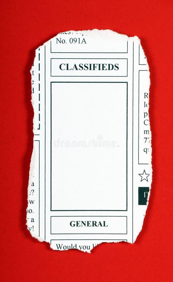 Grampeamento de jornal de Classifieds foto de stock royalty free