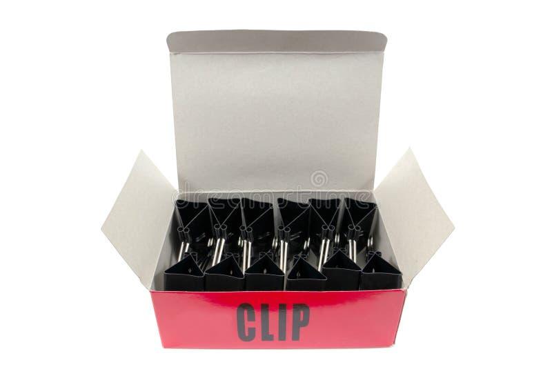 Grampos de buldogue na caixa isolada no fundo branco Clipes de papel na caixa isolada foto de stock royalty free