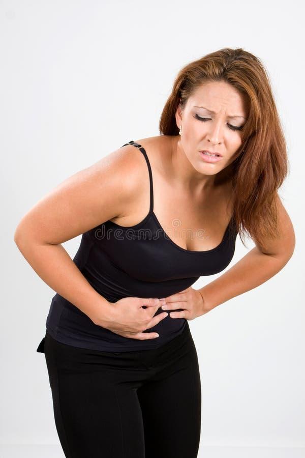 Grampos de estômago dolorosos imagem de stock