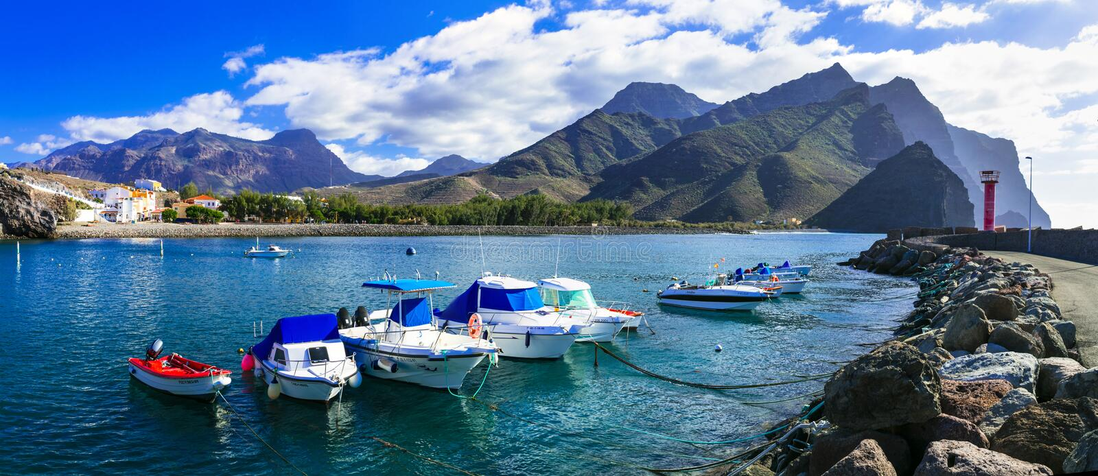 Gran Canaria island- picturesque traditional fishing village La Aldea de San Nicolas de Tolentino. Turquoise sea,traditional fishing boats and mountains,La aldea stock photos