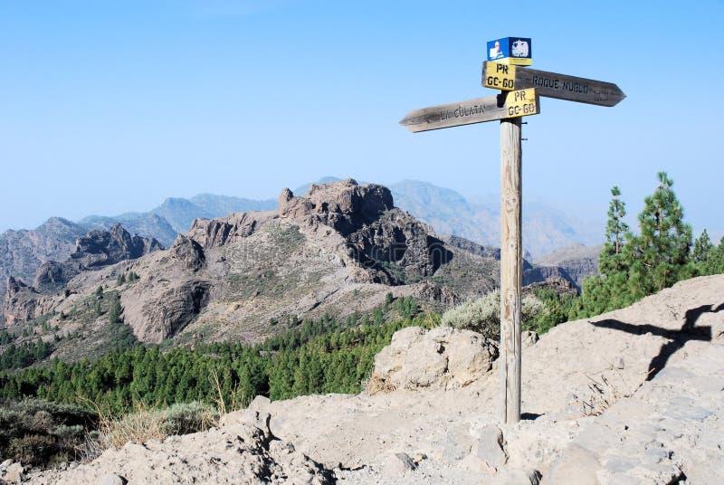 Gran Canaria, rough landscape, mountains, footpath signpost, blue sky. Gran Canaria, interior rough landscape middle of the island with footpath signpost stock photo
