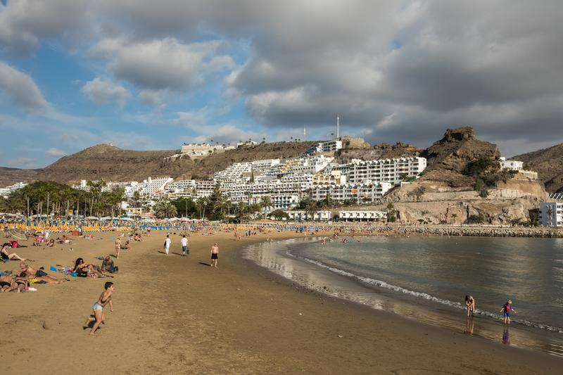 GRAN CANARIA, SPAIN - DECEMBER 10, 2017: People visit Puerto Rico Beach in Gran Canaria, Spain. Canary Islands had 13.3. Million visitors in 2016, with Gran royalty free stock photography