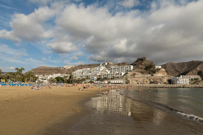 GRAN CANARIA, SPAIN - DECEMBER 10, 2017: People visit Puerto Rico Beach in Gran Canaria, Spain. Canary Islands had 13.3. Million visitors in 2016, with Gran stock photo
