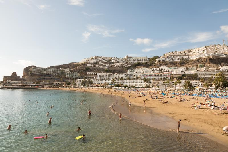 GRAN CANARIA, SPAIN - DECEMBER 10, 2017: People visit Puerto Rico Beach in Gran Canaria, Spain. Canary Islands had 13.3. Million visitors in 2016, with Gran royalty free stock images