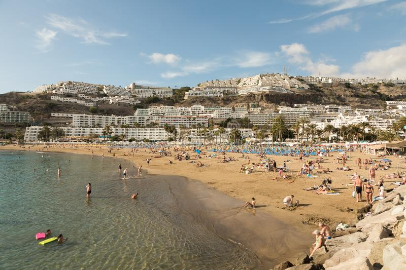 GRAN CANARIA, SPAIN - DECEMBER 10, 2017: People visit Puerto Rico Beach in Gran Canaria, Spain. Canary Islands had 13.3. Million visitors in 2016, with Gran stock image