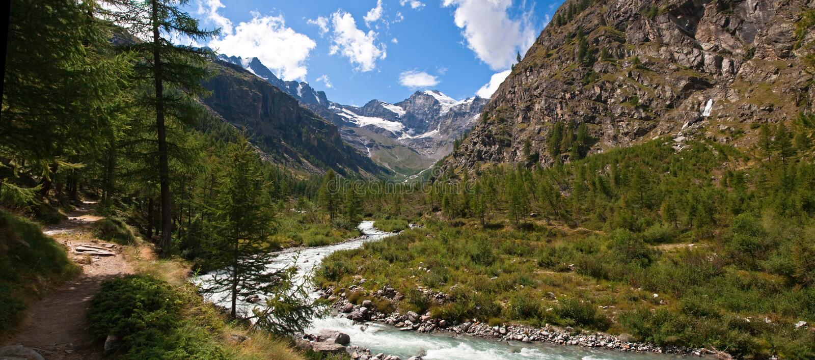 Gran Paradiso National Park. Scenic view of river in Aosta Valley with Alps mountains in background, Gran Paradiso National Park, Italy royalty free stock image