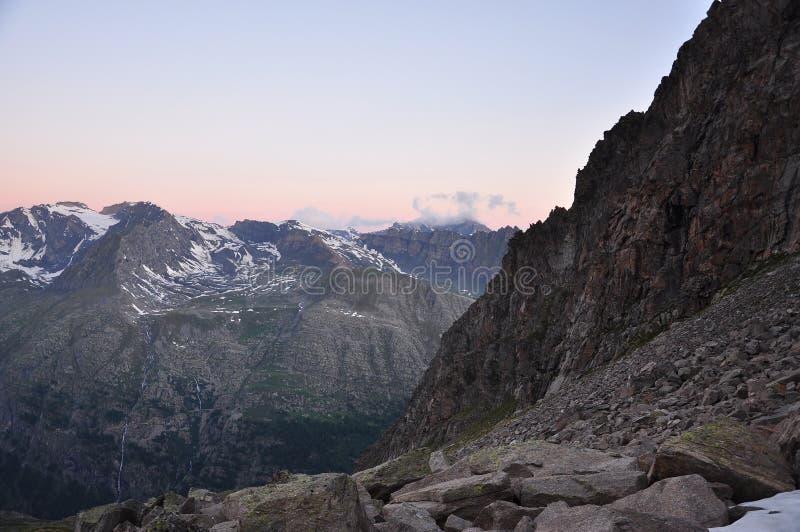 Gran Paradiso national park. Aosta Valley, Italy. Sunrise light on the Gran Paradiso national park peaks. Aosta Valley, Italy stock photo