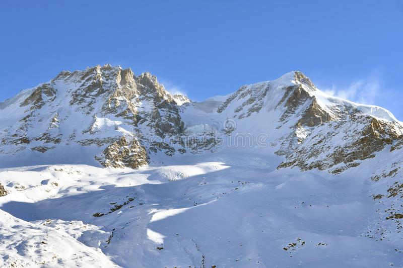 Gran Paradiso. Overview of the peaks of the Gran Paradiso, seen from the Valsavaranche royalty free stock image
