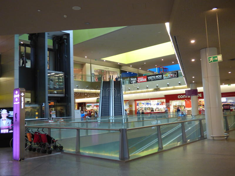 Gran plaza Shopping mall Tavira. Interior of two level shopping mall with lifts escalators and moving walkways royalty free stock images
