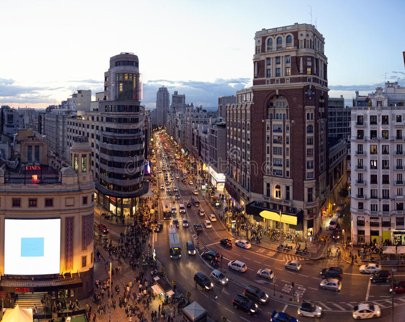 Gran via Madrid. Gran Via in Madrid Spain Many people walk down the Gran Via in Madrid and cars driving on the via stock image