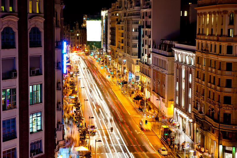 Gran via in madrid. Gran via street in Madrid - Spain capital at night with blurred car lights royalty free stock photography