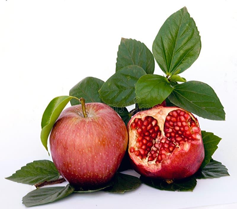 Granaatappel en appel stock afbeeldingen