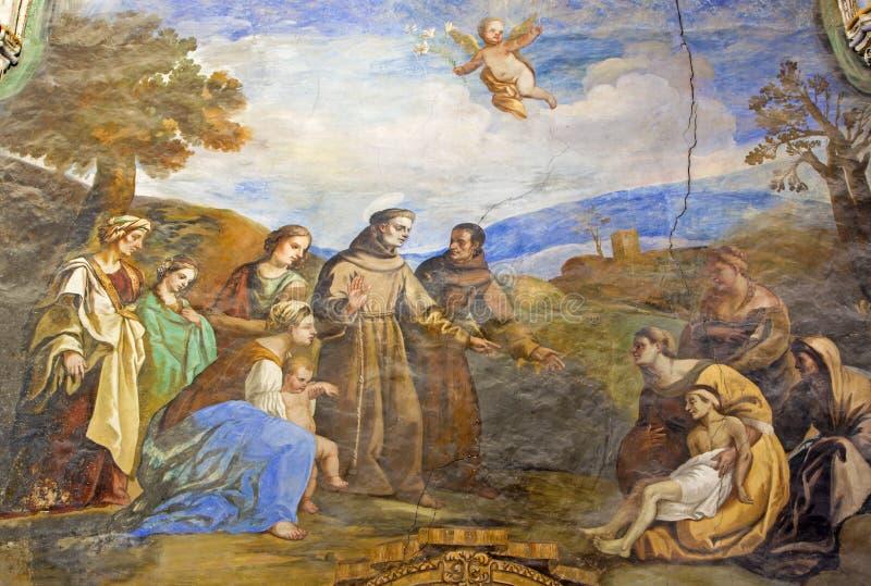 Granada - de fresko van scène als St Anthony van Padua maakt de jonge man voet in de kerk Monasterio DE San Jeronim weer vast royalty-vrije stock afbeeldingen