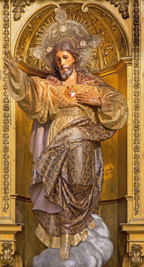 Granada - die geschnitzte und vielfarbige Statue des gehörten Jesuss in der Kirche Real Colegiata de San Hipolito stockbild