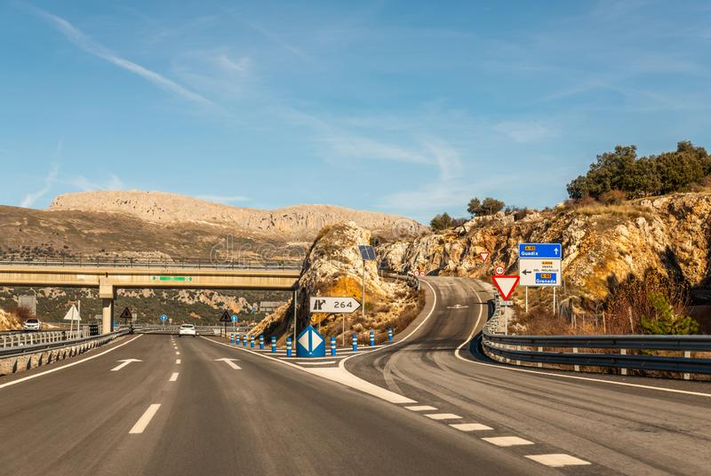 GRANADA SPAIN, DECEMBER 15, 2018 A fast road in the mountains to the city of Granada in Spain, a typical landscape of the region. GRANADA SPAIN, DECEMBER 15 stock photo