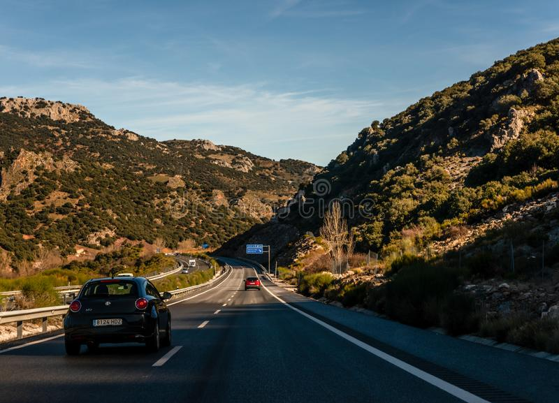 GRANADA SPAIN, DECEMBER 15, 2018 A fast road in the mountains to the city of Granada in Spain, a typical landscape of the region. GRANADA SPAIN, DECEMBER 15 royalty free stock photo