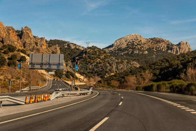GRANADA SPAIN, DECEMBER 15, 2018 A fast road in the mountains to the city of Granada in Spain, a typical landscape of the region. GRANADA SPAIN, DECEMBER 15 stock photos