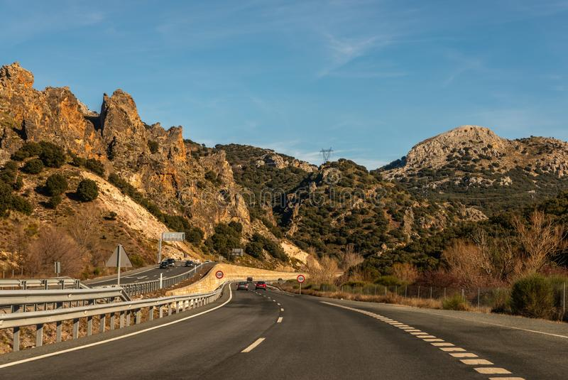 GRANADA SPAIN, DECEMBER 15, 2018 A fast road in the mountains to the city of Granada in Spain, a typical landscape of the region. GRANADA SPAIN, DECEMBER 15 royalty free stock photos