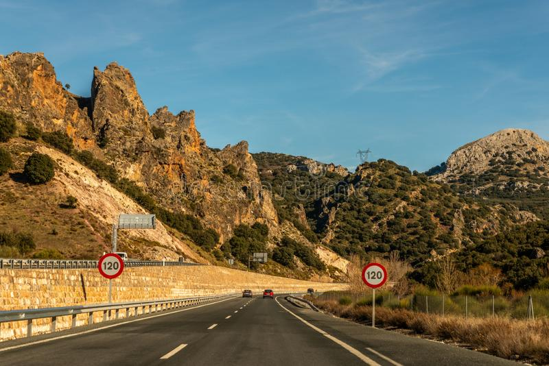 GRANADA SPAIN, DECEMBER 15, 2018 A fast road in the mountains to the city of Granada in Spain, a typical landscape of the region. GRANADA SPAIN, DECEMBER 15 stock image