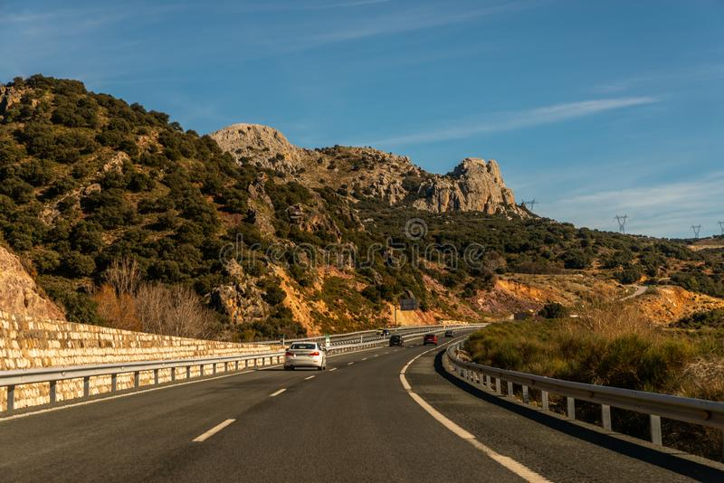 GRANADA SPAIN, DECEMBER 15, 2018 A fast road in the mountains to the city of Granada in Spain, a typical landscape of the region. GRANADA SPAIN, DECEMBER 15 royalty free stock photography