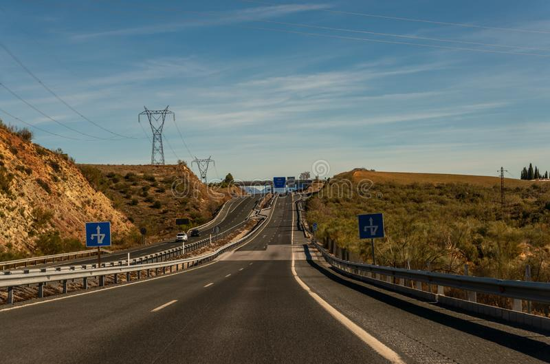 GRANADA SPAIN, DECEMBER 15, 2018 A fast road in the mountains to the city of Granada in Spain, a typical landscape of the region. GRANADA SPAIN, DECEMBER 15 stock images