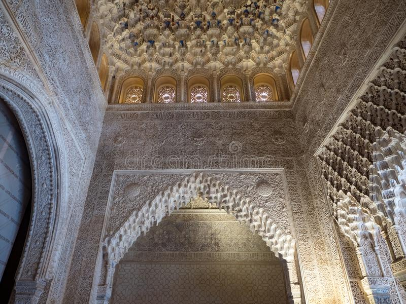 GRANADA, SPAIN - March 2018: Arches and columns of Alhambra. It is a palace and fortress complex located in Granada. stock photography
