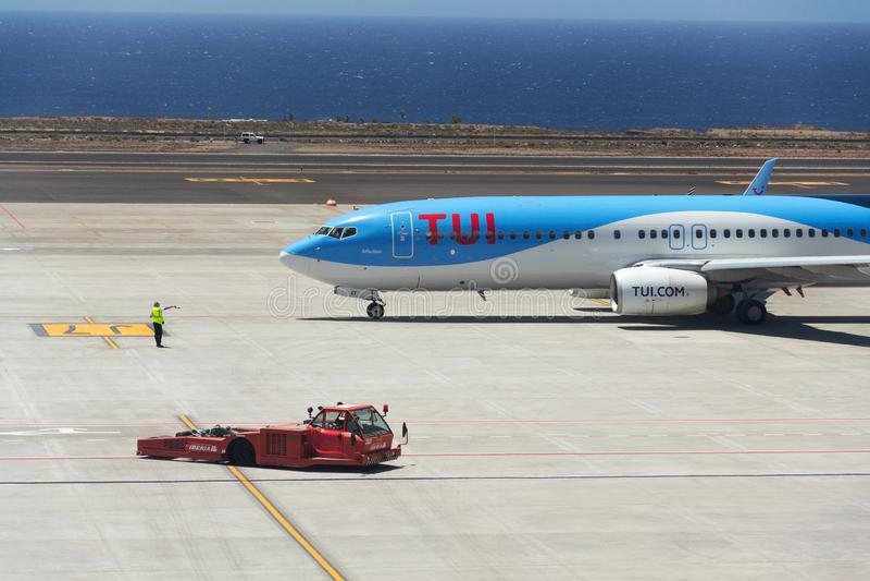 TUI Airway charter airline Boeing 737-800 airplane preparing for flight on airport. GRANADILLA DE ABONA, SPAIN - JULY 13 2019: TUI Airway charter airline Boeing stock images