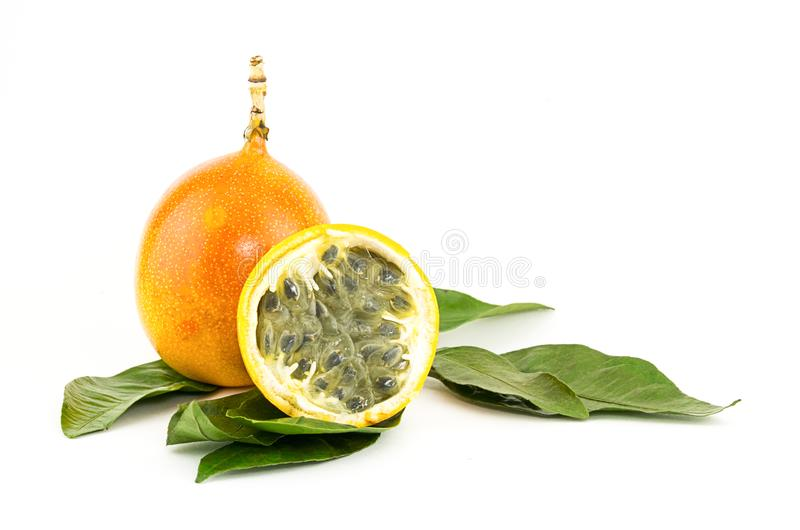 Granadilla whole and a half of fruit sweetly sour filling freshens on green leaves royalty free stock images