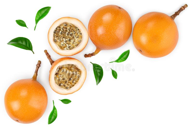 Granadilla or yellow passion fruit with leaf isolated on white background with copy space for your text. Top view. Flat royalty free stock images