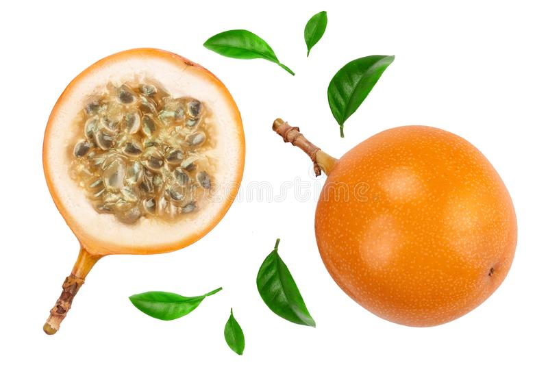 Granadilla or yellow passion fruit with leaf isolated on white background. Top view. Flat lay stock photo