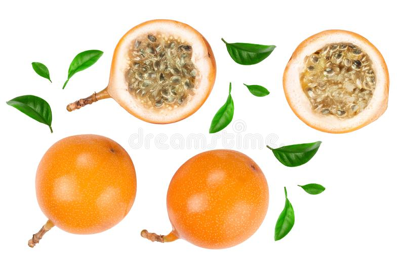 Granadilla or yellow passion fruit with leaf isolated on white background. Top view. Flat lay royalty free stock photo