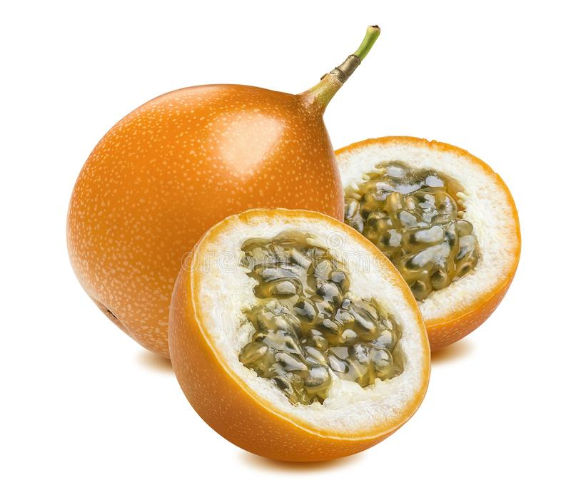 Granadilla or yellow passion fruit pieces isolated on white stock images