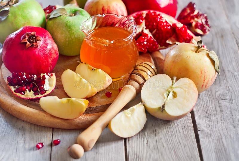 Granatapfel, Äpfel und Honig lizenzfreie stockfotos