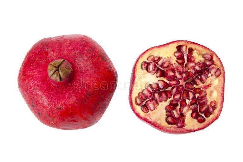 Granatapfel und eine Hälfte stockbild