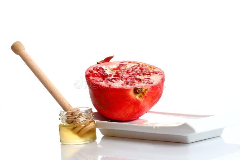 Granatapfel und Honig stockbilder