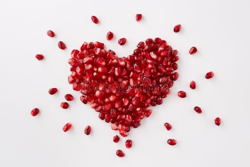 Granatowów ziarna w kształcie serce fotografia stock