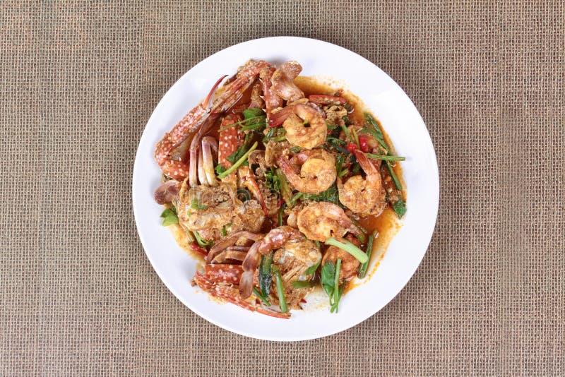 Granchio-gamberetto in padella, curry fotografia stock