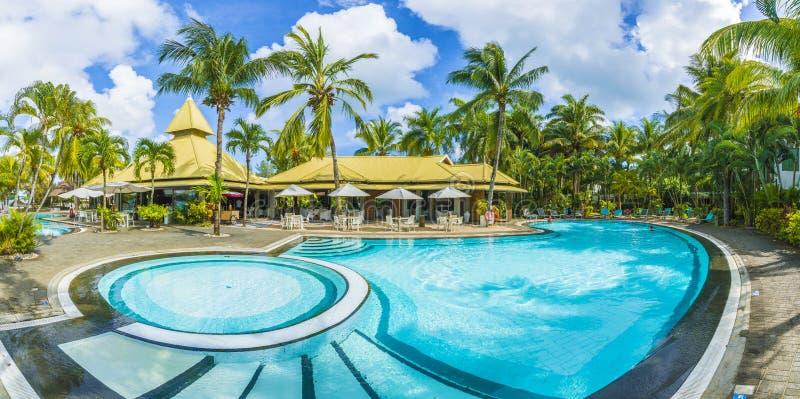 Grand baie, Mauritius - February 18, 2018: Luxury resort with swim pool at Grand baie on Mauritius island, Africa. Grand baie, Mauritius - February 18, 2018 royalty free stock photos