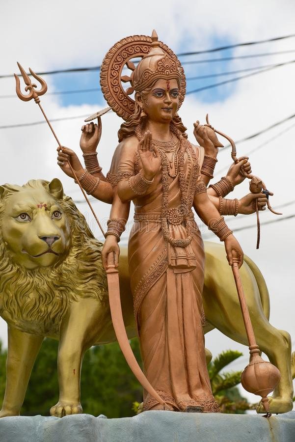 Giant Durga godess with a lion statue at Ganga Talao Grand Bassin Hindu temple, Mauritius. royalty free stock images