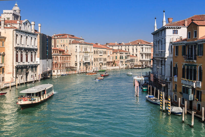 Grand Canal. The Grand Canal in Venice in spring with vaporetto and other boats running on the canal royalty free stock image