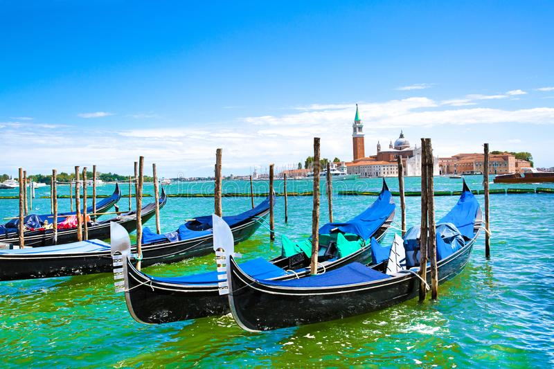 Grand Canal, Gondolas and turquoise water of canal in Venice, Italy. Summer vacations. Gondolas and bright turquoise water of canal. Grand Canal in Venice, Italy stock photo
